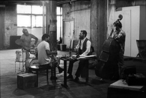 Ornette Coleman Quartet: L-R: Dewey Redman ts Ed Blackwell dr Ornette Coleman as Charlie Haden b rehearsal at Artist House Prince Street New York City 1971